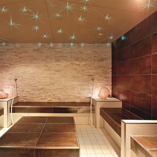 Modern steam bath with salt crystal lights in the Romantikhotel Zell am See