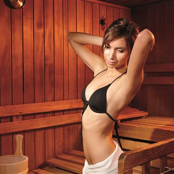 Lady in the adults-only sauna in the romantic hotel in Zell am See