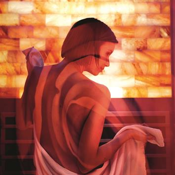 Lady with towel in the sauna of the Romantikhotel Zell am See