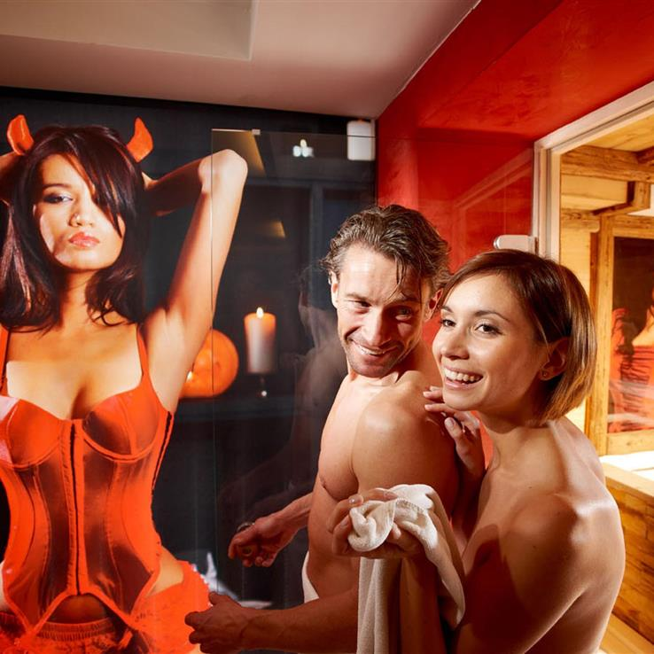 Couple in the adults-only sauna with devilish picture
