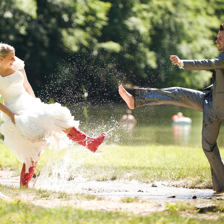 Wedding couple happy with splashing in the water
