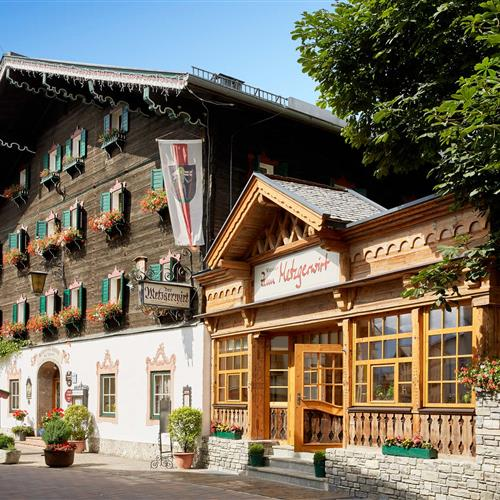 View of the wooden facade and the new winter garden of the Romantik Hotel & Gasthaus zum Metzgerwirt