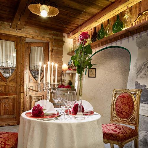 Small, romantic decorated table for two with candle light