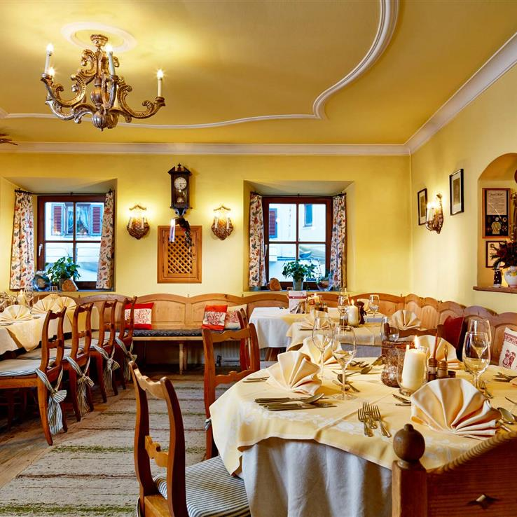 Covered tables in the cosy parlour at the Romantikhotel in Zell am See, Austria
