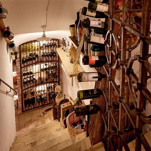 Staircase in the wine cellar with wine bottles