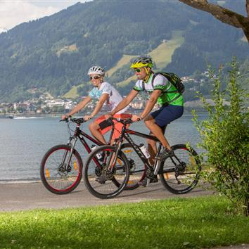 Couple with bike equipment on the lake shore of Lake Zell
