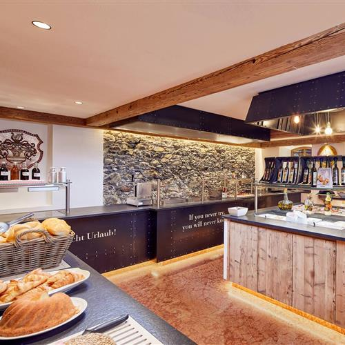 New buffet area with show kitchen,sideboard with fresh bread, dressings and salads