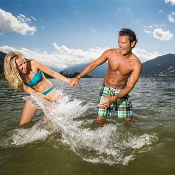 Couple splashing in lake Zeller