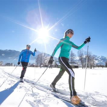 Couple on cross-country skiing in Zell am See