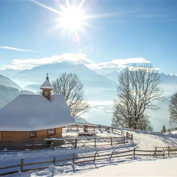 Snow-covered chapel with a panoramic view of Lake Zell, Salzburg